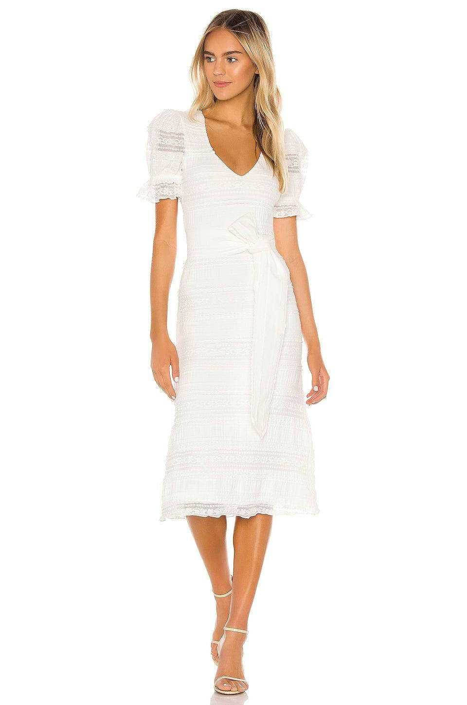 """<p>This <a href=""""https://www.popsugar.com/buy/Tularosa-Quinn-Midi-Dress-579968?p_name=Tularosa%20Quinn%20Midi%20Dress&retailer=revolve.com&pid=579968&price=168&evar1=fab%3Aus&evar9=33517892&evar98=https%3A%2F%2Fwww.popsugar.com%2Ffashion%2Fphoto-gallery%2F33517892%2Fimage%2F47532439%2FTularosa-Quinn-Midi-Dress&list1=shopping%2Csummer%2Clace%2Csummer%20fashion&prop13=api&pdata=1"""" class=""""link rapid-noclick-resp"""" rel=""""nofollow noopener"""" target=""""_blank"""" data-ylk=""""slk:Tularosa Quinn Midi Dress"""">Tularosa Quinn Midi Dress</a> ($168) is one you're always going to want to wear. </p>"""