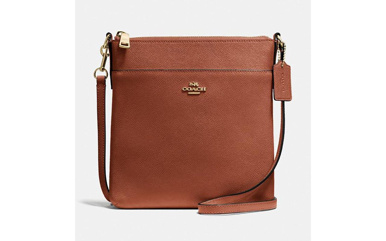 "<p>To buy: <a href=""https://click.linksynergy.com/deeplink?id=93xLBvPhAeE&mid=37299&murl=https%3A%2F%2Fwww.coach.com%2Fcoach-kitt-messenger-crossbody%2F41320.html%3F&u1=TL%2CCoach%25E2%2580%2599sEpicHolidaySaleHasAmazingDealsonTravelAccessories%25E2%2580%2594Here%25E2%2580%2599sWhattoShop%2Cszypulsr%2CSHO%2CGAL%2C654816%2C201911%2CI"" target=""_blank"">coach.com</a>, $105 with code SAVE30 (originally $150)</p>"