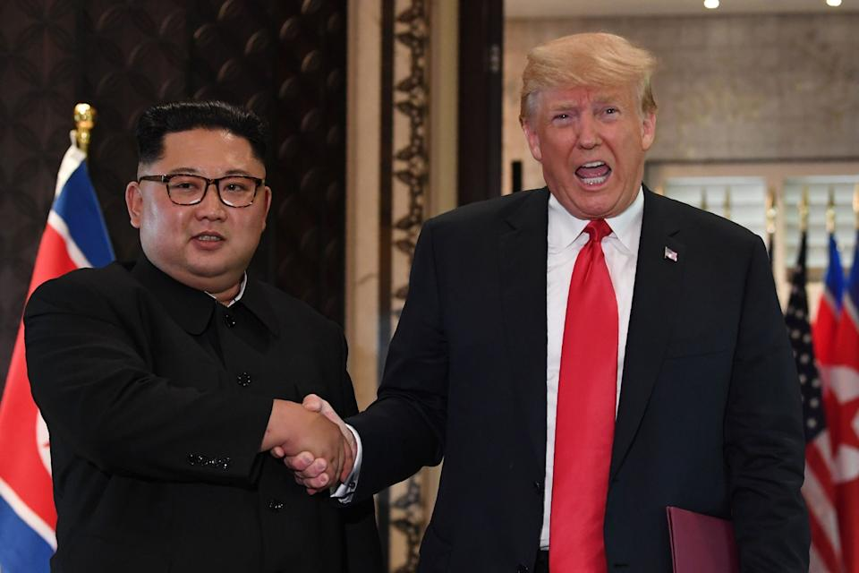 Donald Trump and Kim Jong Un shake hands following a signing ceremony during their historic US-North Korea summit in 2018: AFP/Getty Images