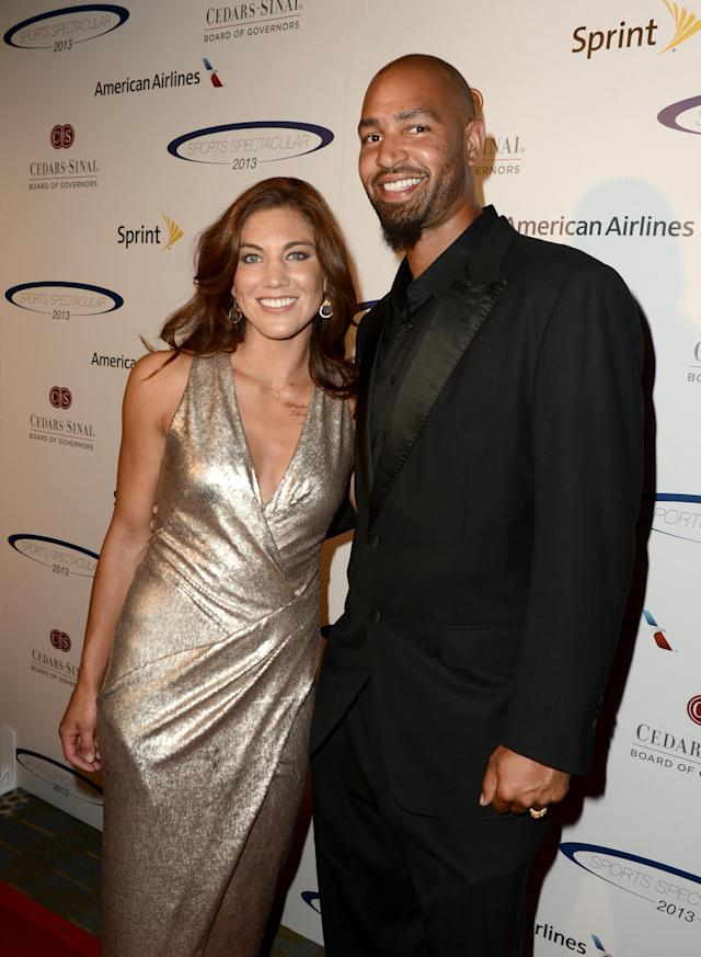 CENTURY CITY, CA - MAY 19: Pro soccer player and honoree Hope Solo and former pro football player Jerramy Stevens attend the 28th Anniversary Sports Spectacular Gala at the Hyatt Regency Century Plaza on May 19, 2013 in Century City, California. (Photo by Kevin Winter/Getty Images for Sports Spectacular)