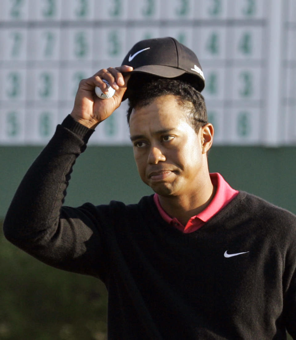 <p>Tiger Woods tips his cap on the 18th hole during the final round of the 2007 Masters golf tournament at the Augusta National Golf Club in Augusta, Ga., Sunday, April 8, 2007. (AP Photo/Elise Amendola) </p>