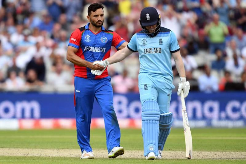 Eoin Morgan is congratulated by Afghanistan's Gulbadin Naib after the England captain lost his wicket for 148 runs.