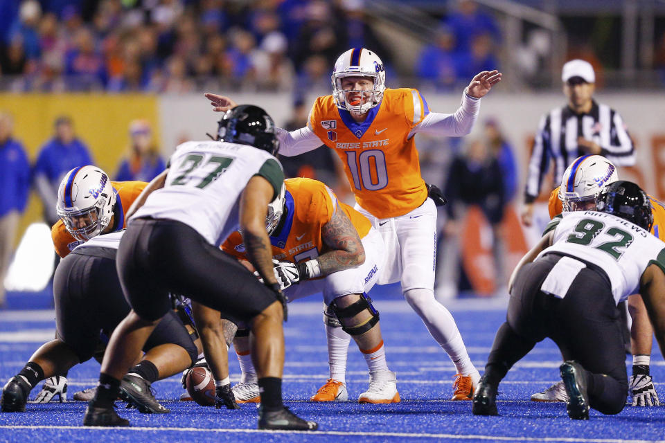 Boise State quarterback Chase Cord (10) calls signals at the line of scrimmage duirng the team's NCAA college football game against Hawaii, Saturday, Oct. 12, 2019, in Boise, Idaho. (AP Photo/Steve Conner)