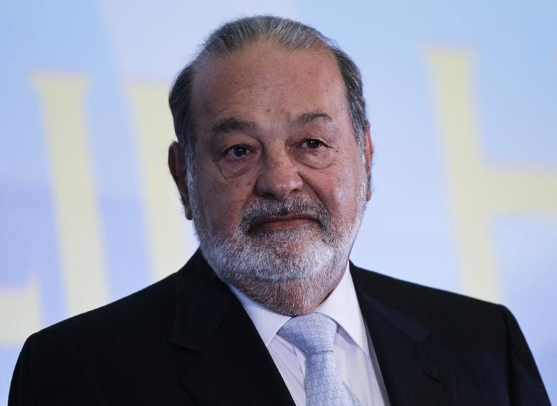 Mexican billionaire Carlos Slim looks on before he gives a speech at Mexico's school of engineers during an event to mark the 50th anniversary of his engineering degree, in Mexico City