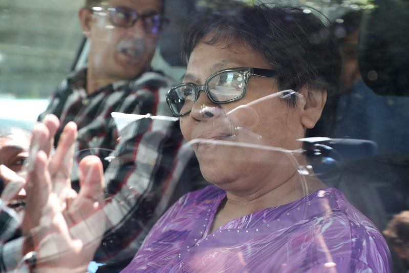 Australian Maria Elvira Pinto Exposto gestures as she leaves following her acquiting at the Federal Court in Putrajaya