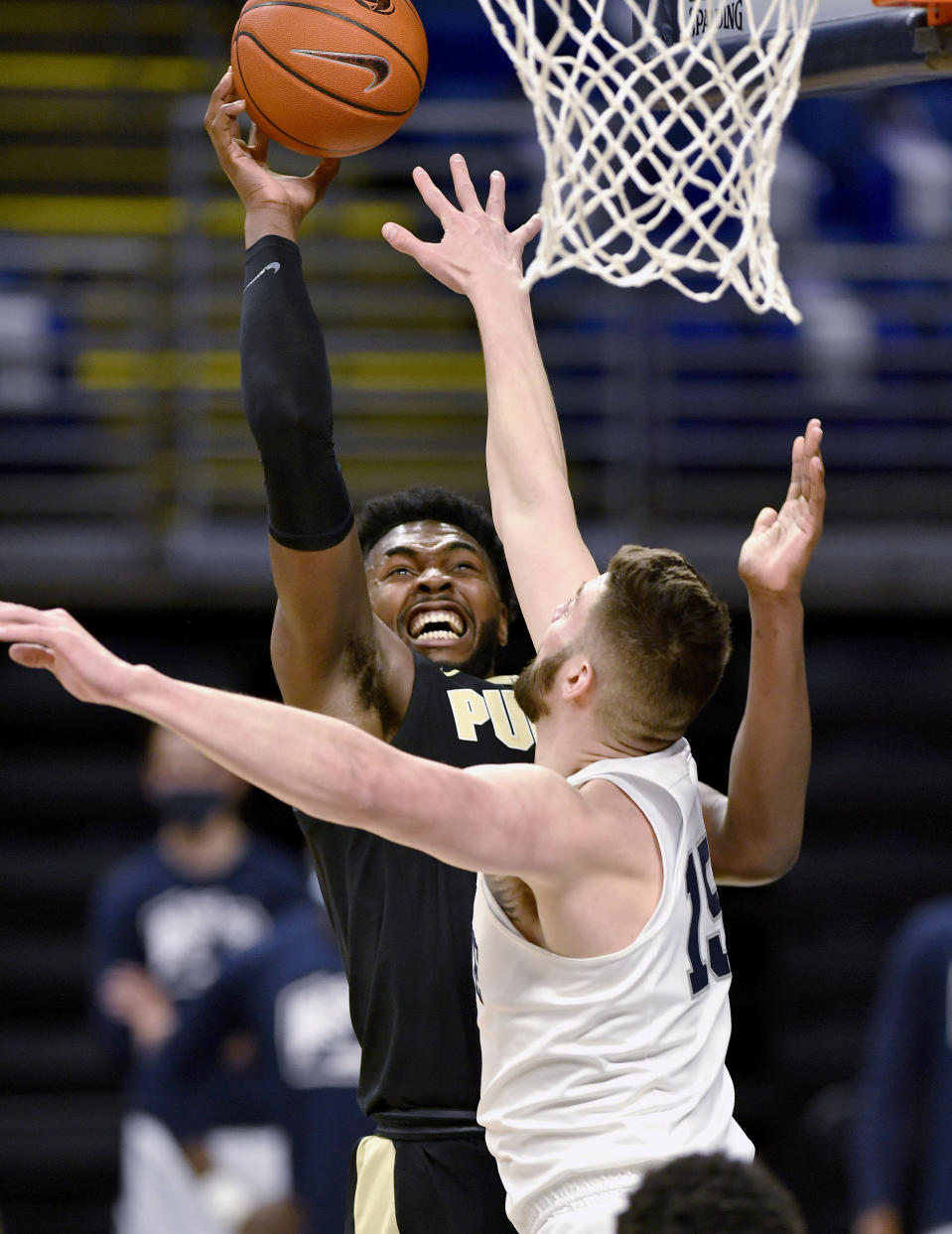 Purdue's Trevion Williams shoots over Penn State's Trent Buttrick during an NCAA college basketball game Friday, Feb. 26, 2021, in State College, Pa. (Abby Drey/Centre Daily Times via AP)