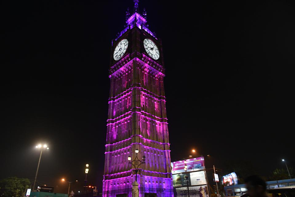 KOLKATA, INDIA NOVEMBER 21: A replica of Britains iconic tower Big Ben is lit in pink to mark India's Pink Ball test match against Bangladesh, at Lake Town, on November 21, 2019 in Kolkata, India. (Photo by Samir Jana/Hindustan Times via Getty Images)