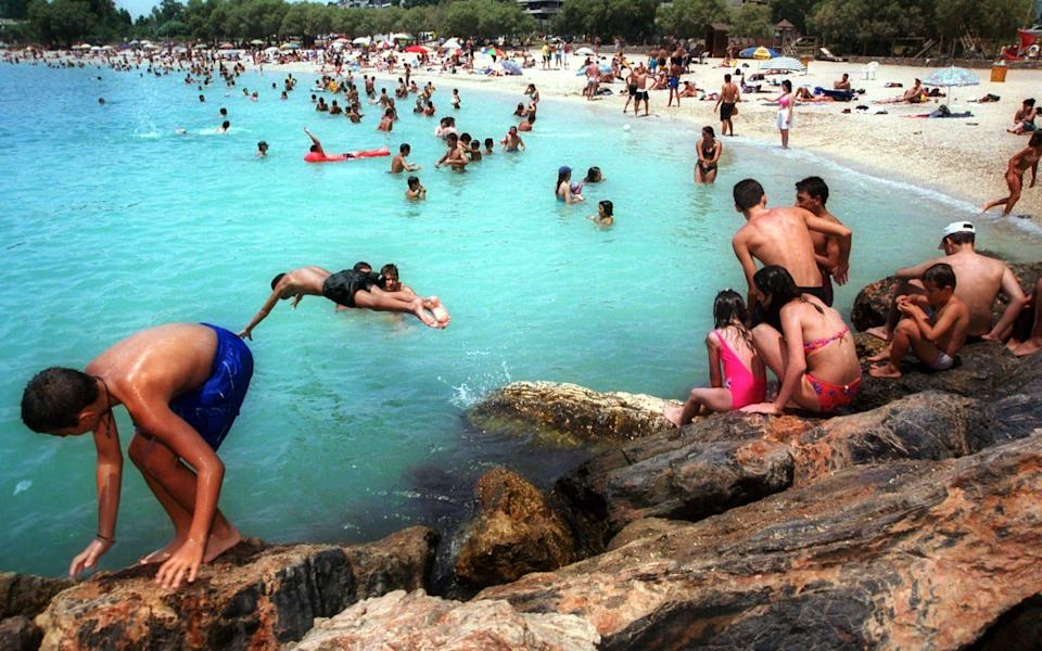 A beach in Greece during normal times. Athens wants a vaccine passport in order to rescue its summer tourism season - THALASSINI DOUMA/AP