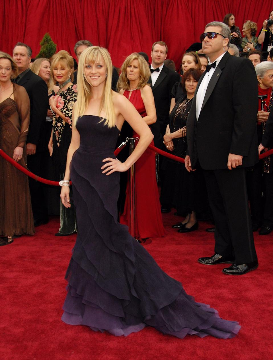 <p>The actress wore a tiered Nina Ricci gown dyed varying degrees of purple to the awards in 2007.</p>