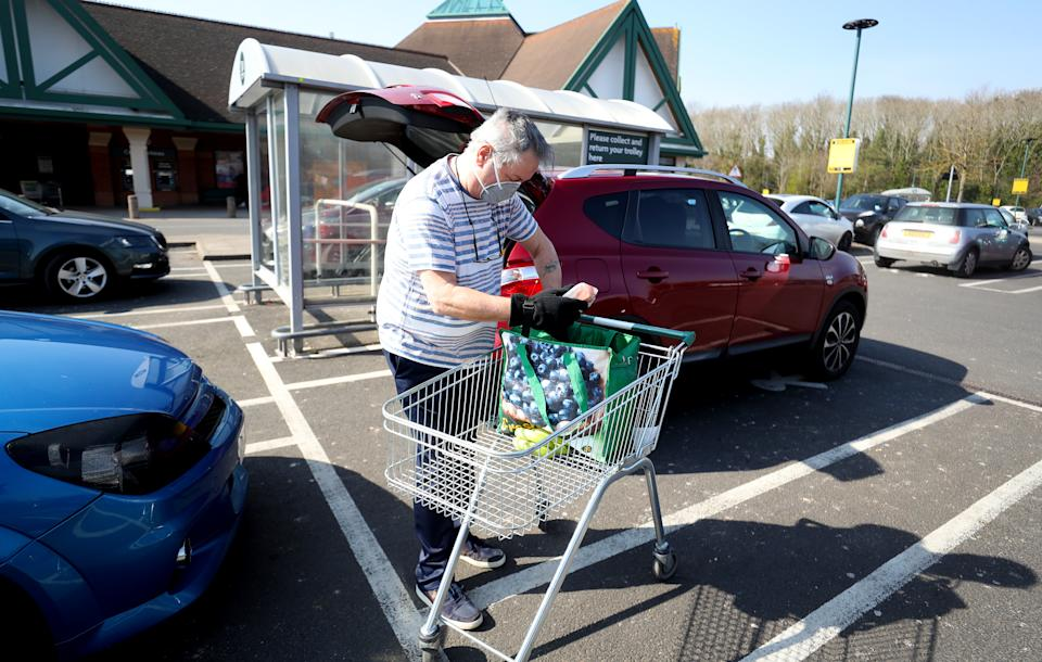 A man outside Morrisons supermarket in Malvern, the day after Prime Minister Boris Johnson put the UK in lockdown to help curb the spread of the coronavirus.