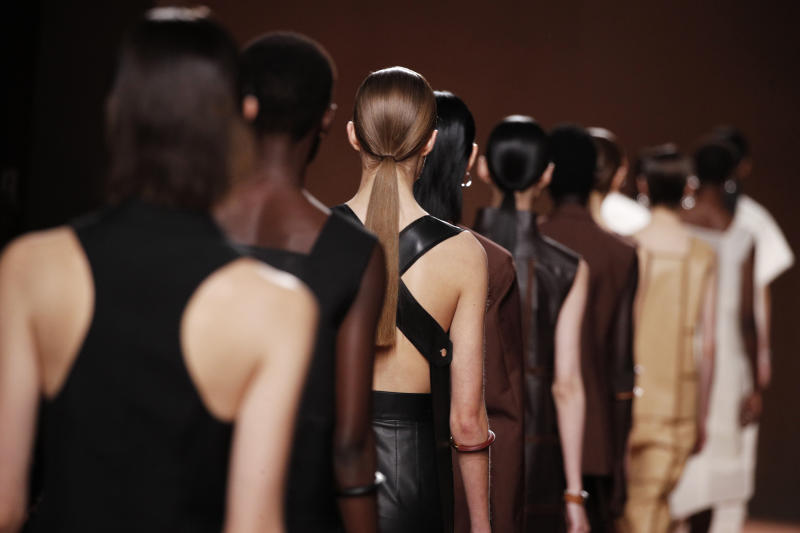 Models wear creations as part of the Hermes Ready To Wear Spring-Summer 2020 collection, unveiled during the fashion week, in Paris, Saturday, Sept. 28, 2019. (AP Photo/Francois Mori)