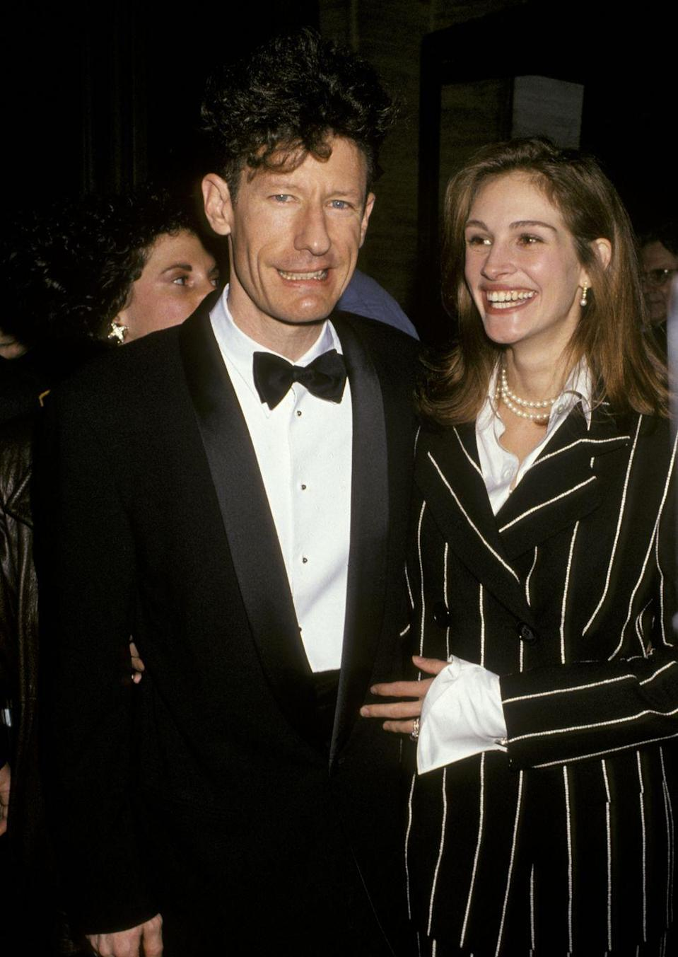 """<p>Back in 1993, Julia and country singer Lyle had a surprise wedding, with Lyle's manager telling the <a href=""""https://www.washingtonpost.com/archive/lifestyle/1993/06/28/julia-roberts-and-lyle-lovett-make-a-mad-dash-to-the-altar/c6a19041-93b8-4bce-9929-4bdb86d8faa9/?utm_term=.05397a52e541"""" rel=""""nofollow noopener"""" target=""""_blank"""" data-ylk=""""slk:Washington Post"""" class=""""link rapid-noclick-resp""""><em>Washington Post</em></a> at the time that """"it happened rapidly, very rapidly."""" """"I feel liberated in a way,"""" Julia reportedly <a href=""""http://people.com/archive/cover-story-one-last-sad-song-vol-43-no-14/"""" rel=""""nofollow noopener"""" target=""""_blank"""" data-ylk=""""slk:told Premiere magazine"""" class=""""link rapid-noclick-resp"""">told <em>Premiere</em> magazine</a> while married. """"I feel like this really pleasant calm has descended upon my life."""" The calm didn't last—the couple split after 21 months together.</p>"""
