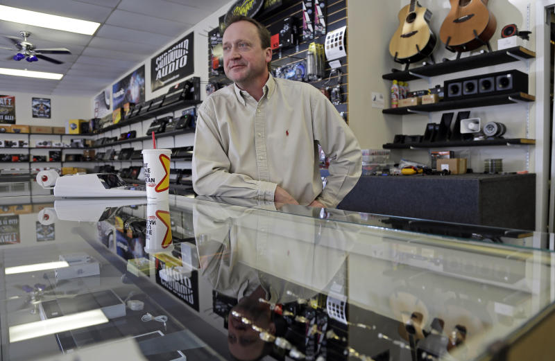 In this Monday, March 4, 2013 photo taken in Fayetteville, N.C., Tom Raper, owner of Bragg Pawn Shop, talks about small business near Fort Bragg military base. His pawn shop is located on Yadkin Road near a main entrance to the base. More than 8,500 civilian employees on the base will be furloughed one day a week starting in late April, the equivalent of a 20-percent pay cut, possibly affecting small businesses near the base. (AP Photo/Gerry Broome)