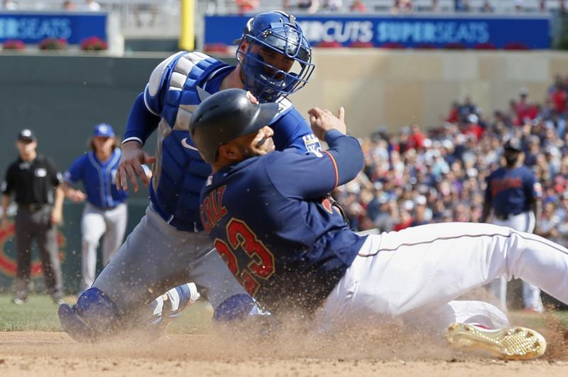 Minnesota Twins' Nelson Cruz, right, is tagged out at the plate by Kansas City Royals catcher Cam Gallagher as he tried to score from third on a single by Eddie Rosario in the eighth inning of a baseball game Sunday, Aug. 4, 2019, in Minneapolis. The Twins won 3-0. (AP Photo/Jim Mone)