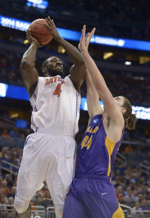 Florida center Patric Young (4) drives to the basket over Albany center John Puk (44) during the first half of a second-round game in the NCAA college basketball tournament on Thursday, March 20, 2014, in Orlando, Fla. (AP Photo/Phelan M. Ebenhack)