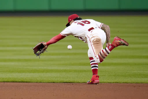St. Louis Cardinals second baseman Kolten Wong is unable to reach a single by Milwaukee Brewers' Orlando Arcia during the fifth inning of a baseball game Saturday, Sept. 26, 2020, in St. Louis. (AP Photo/Jeff Roberson)
