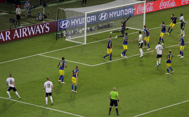 Germany's Toni Kroos, far left, scores his side's second goal during the group F match between Germany and Sweden at the 2018 soccer World Cup in the Fisht Stadium in Sochi, Russia, Saturday, June 23, 2018. (AP Photo/Sergei Grits)