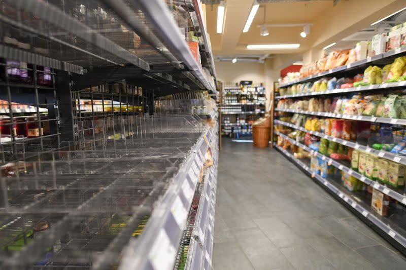 FILE PHOTO: Partially emptied shelves in a Munich supermarket