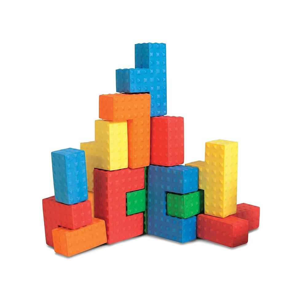 "<p>The <a href=""https://www.popsugar.com/buy/Edushape-Easy-Grip-Soft-Foam-Sensory-Puzzle-Blocks-122469?p_name=Edushape%20Easy%20Grip%20Soft%20Foam%20Sensory%20Puzzle%20Blocks&retailer=amazon.com&pid=122469&price=20&evar1=moms%3Aus&evar9=25800161&evar98=https%3A%2F%2Fwww.popsugar.com%2Fphoto-gallery%2F25800161%2Fimage%2F44870149%2FEdushape-Easy-Grip-Soft-Foam-Sensory-Puzzle-Blocks&list1=gifts%2Choliday%2Cgift%20guide%2Cparenting%2Cautism%2Clittle%20kids%2Ckid%20shopping%2Choliday%20for%20kids%2Cgifts%20for%20toddlers%2Cbest%20of%202019&prop13=api&pdata=1"" class=""link rapid-noclick-resp"" rel=""nofollow noopener"" target=""_blank"" data-ylk=""slk:Edushape Easy Grip Soft Foam Sensory Puzzle Blocks"">Edushape Easy Grip Soft Foam Sensory Puzzle Blocks</a> ($20) are sensory blocks that are perfect for little hands to focus on as they build and create.</p>"