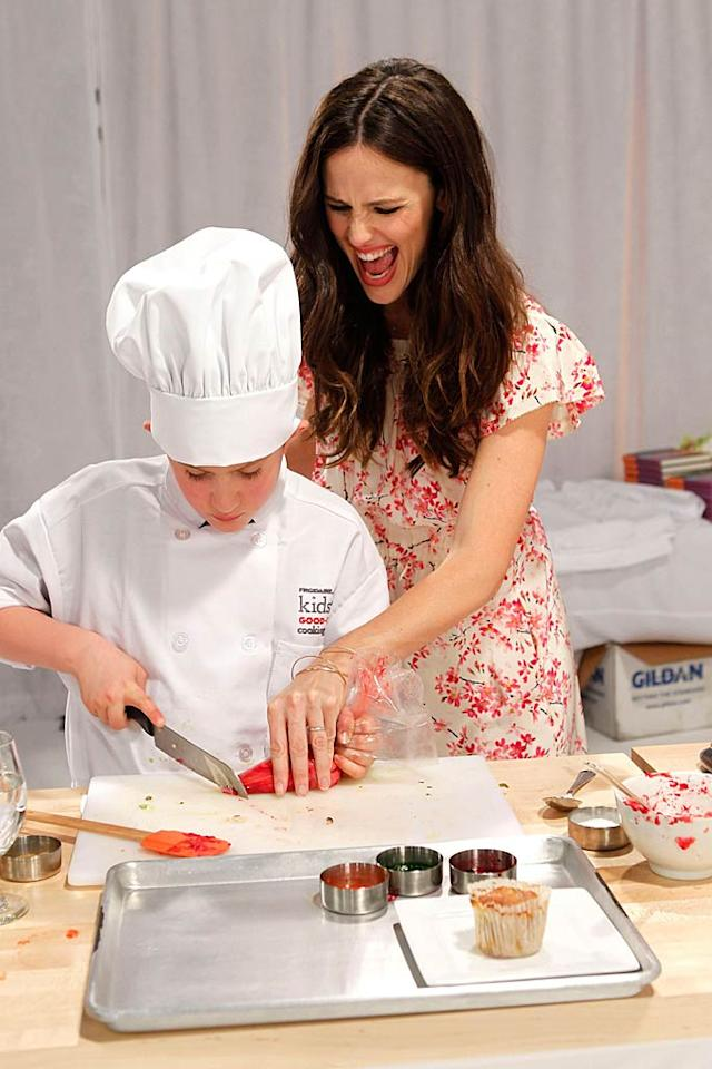 "Jennifer Garner melted hearts -- and chocolate -- when she helped Frigidaire launch The Kids' Cooking Academy on Tuesday in Los Angeles. The online cooking lessons aim to inspire families to feed their kids healthy meals that they can all make together. ""It's so important to teach kids how to feed their bodies,"" said Garner. ""You can't learn, you can't pay attention in school, and you can't be active if your brain isn't well-fed and if your body isn't healthy. The Frigidaire Kids' Cooking Academy is a great way to start involving your kids in the kitchen."" Jeff Vespa/<a href=""http://www.wireimage.com"" target=""new"">WireImage.com</a> - January 18, 2011"