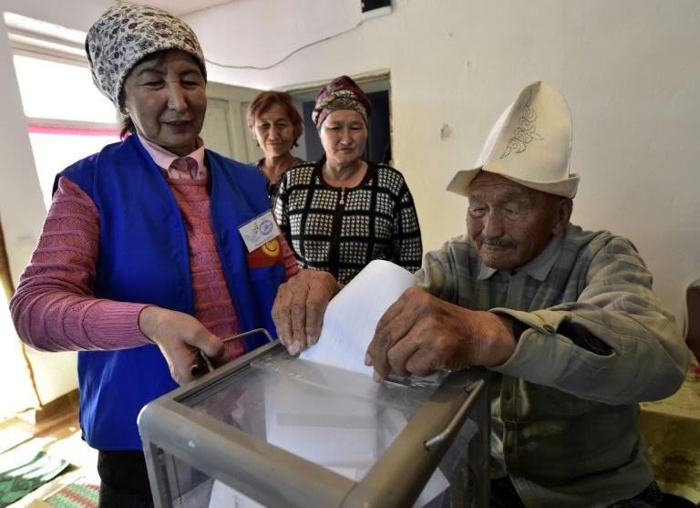 Around 24% of the electorate cast their ballots in the first six hours, with some older people voting at home such as this man in Arashan village just outside the Kyrgyz capital, Bishkek