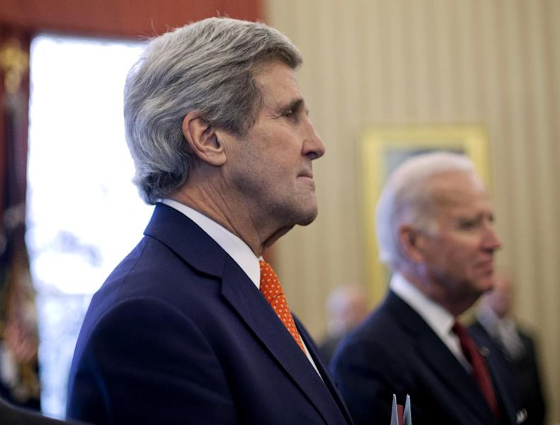 Secretary of State John Kerry, left, and Vice President Joe Biden listen to President Barack Obama answers a question regarding the ongoing situation in the Ukraine, during his meeting with Israeli Prime Minister Benjamin Netanyahu, Monday, March 3, 2014, in the Oval Office of the White House in Washington. Kerry will travel to the Ukrainian capital of Kiev tomorrow to meet with government officials and comes as the U.S. and other Western nations weigh a response to Russia's military advance into Ukraine. (AP Photo/Pablo Martinez Monsivais)