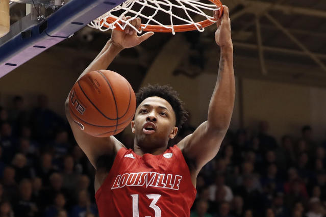 Louisville guard David Johnson dunks against Duke during the first half of an NCAA college basketball game in Durham, N.C., Saturday, Jan. 18, 2020. (AP Photo/Gerry Broome)