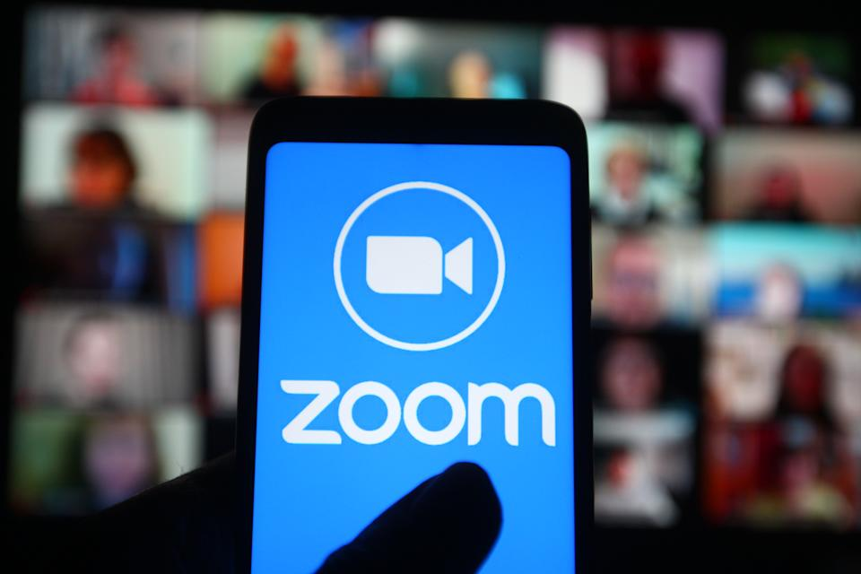 UKRAINE - 2021/03/02: In this photo illustration a Zoom logo of a company that provides video communications and online chat services is seen on a smartphone screen. (Photo Illustration by Pavlo Gonchar/SOPA Images/LightRocket via Getty Images)