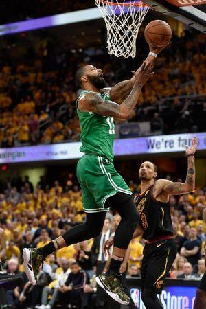 May 21, 2018; Cleveland, OH, USA; Boston Celtics forward Marcus Morris (13) attempts a layup in front of Cleveland Cavaliers guard George Hill (3) during the forth quarter in game four of the Eastern conference finals of the 2018 NBA Playoffs at Quicken Loans Arena. Mandatory Credit: David Richard-USA TODAY Sports