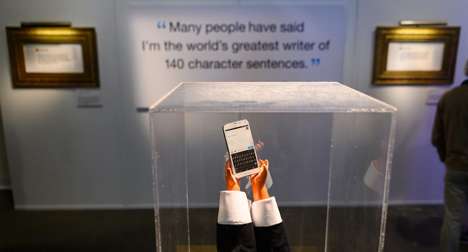 A display with tiny hands seen near Trumps' tweets at an exhibition in Washington DC