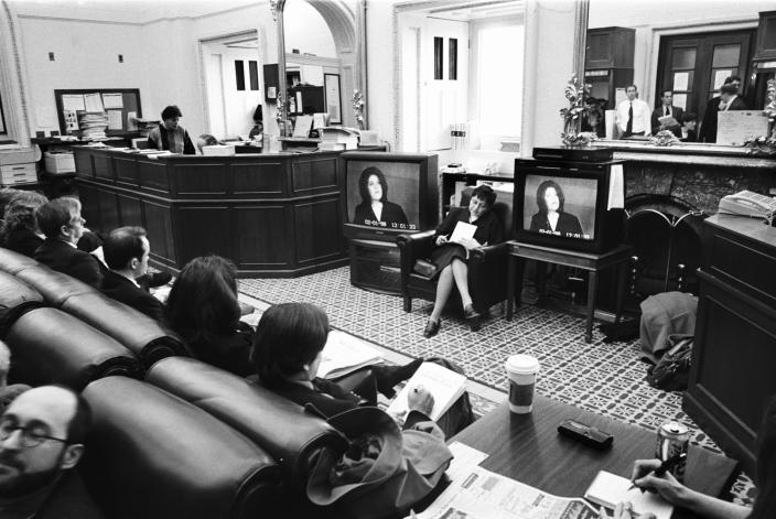 Reporters listen remotely to the testimony of Monica Lewinsky during the Clinton impeachment trial in the Senate in 1999. (Photo: David Hume Kennerly/Getty Images)