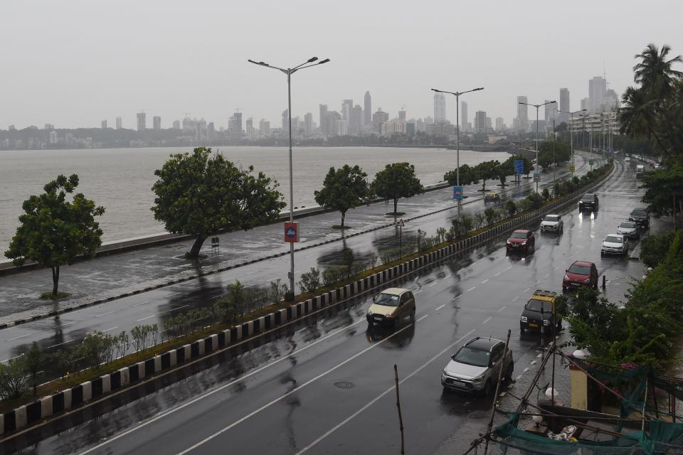 Commuters drive along Marine Drive as rain falls in Mumbai on June 3, 2020. (Photo by PUNIT PARANJPE/AFP via Getty Images)