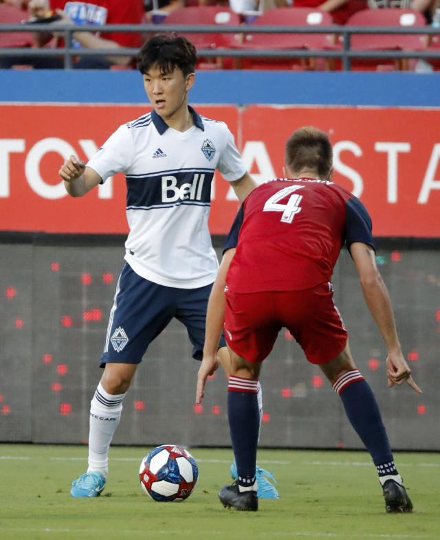 Vancouver Whitecaps's Inbeom Hwang (4) works to make a pass as FC Dallas' Bressan (4) defends during the first half of an MLS soccer match in Frisco, Texas, Wednesday, June 26, 2019. (AP Photo/Tony Gutierrez)