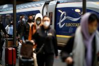 Passengers arrive at the Eurostar terminal at Gare du Nord train station in Paris