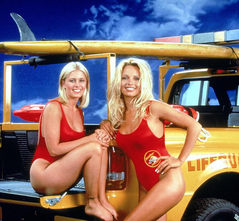 Pamela appeared on Baywatch for five years, pictured here with co-star Nicole Eggert. Photo: Getty