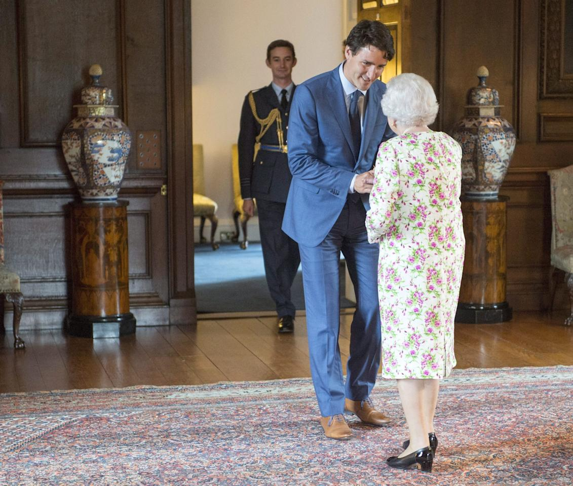 <p>On his second official audience with the Queen, he gifted the monarch the Canadian flag that flew above the Peace Tower on Canada's 150th birthday, July 1, 2017. (Canadian Press) </p>