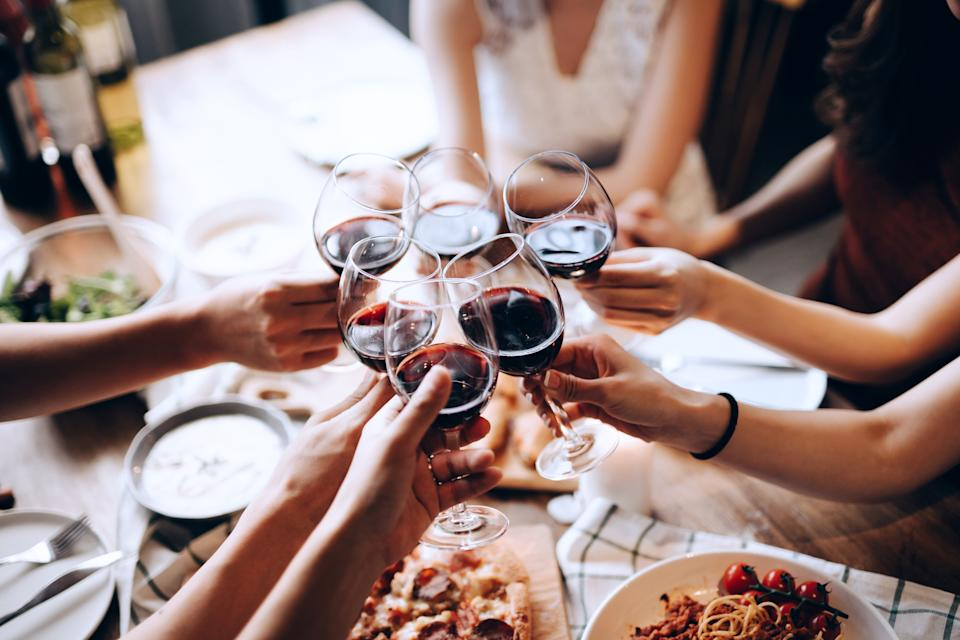 Toast with red wine at dinner with your friends. (PHOTO: Getty Images)