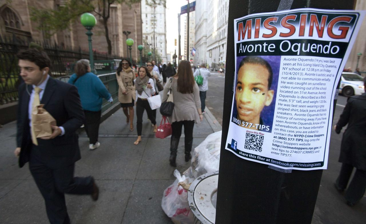 A poster for Avonte Oquendo, a missing 14-year-old autistic child, is seen in downtown New York October 15, 2013. Oquendo has been missing for 11 days since walking out of his school on October 4, and a $70,000 reward has been offered for his safe return. REUTERS/Carlo Allegri (UNITED STATES - Tags: SOCIETY)