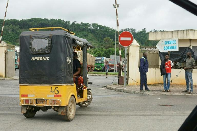 'It's no good right now -- we aren't making any money,' says the driver of a motorised tricycle taxi (AFP/Issouf SANOGO)
