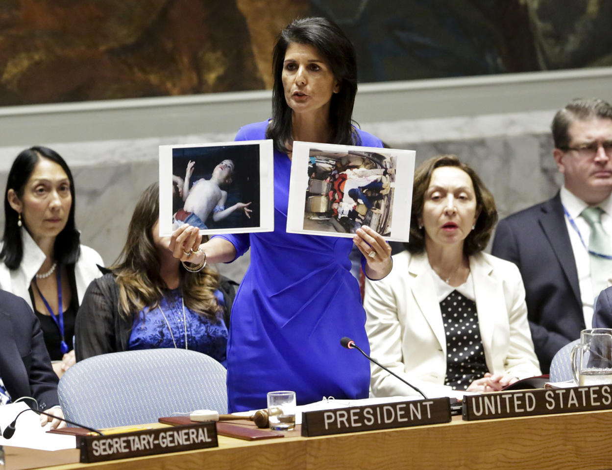 <p>Nikki Haley, United States' Ambassador United Nations, shows pictures of Syrian victims of chemical attacks as she addresses a meeting of the Security Council on Syria at U.N. headquarters, Wednesday, April 5, 2017. (Photo: Bebeto Matthews/AP) </p>