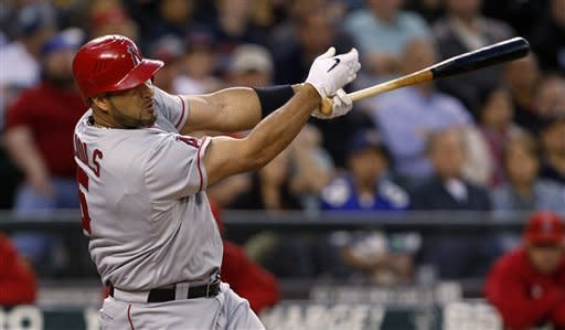 Los Angeles Angels' Albert Pujols hits a three-run home run against the Seattle Mariners in the sixth inning in a baseball game Friday, May 25, 2012, in Seattle. (AP Photo/Elaine Thompson)