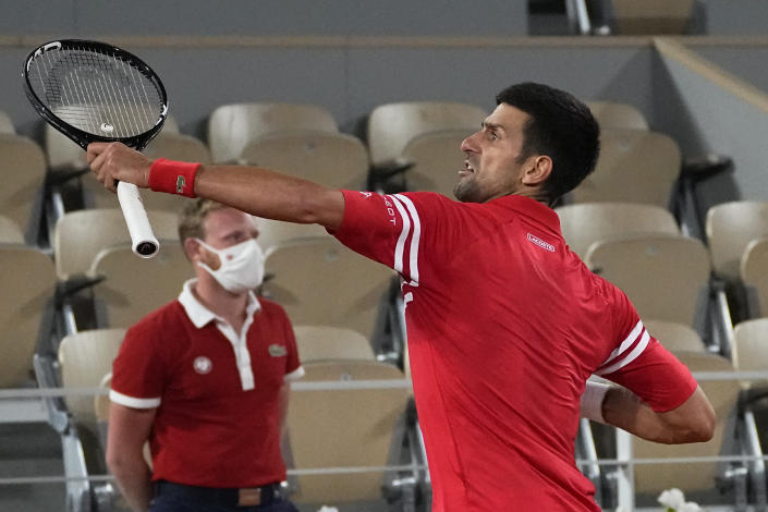 Serbia's Novak Djokovic reacts as he defeats Italy's Matteo Berrettini in a quarterfinal match of the French Open tennis tournament at the Roland Garros stadium Wednesday, June 9, 2021 in Paris. (AP Photo/Michel Euler)
