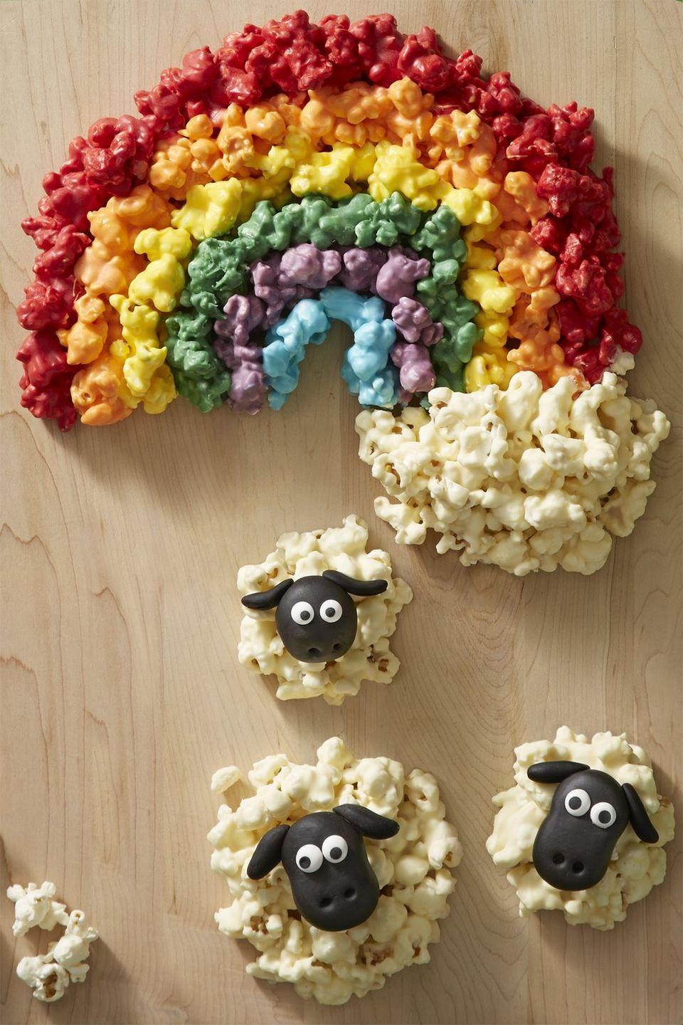 "<p>What lies at the end of the rainbow? We hope it's this light and tasty colorful popcorn snack!</p><p><em><a href=""https://www.womansday.com/food-recipes/food-drinks/recipes/a58124/popcorn-rainbow-recipe/"" rel=""nofollow noopener"" target=""_blank"" data-ylk=""slk:Get the recipe from Woman's Day »"" class=""link rapid-noclick-resp"">Get the recipe from Woman's Day »</a></em></p>"