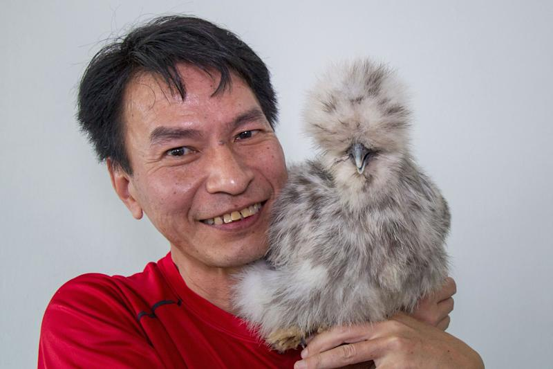 Eric Woo with his Silkie named Splash. (PHOTO: Dhany Osman / Yahoo News Singapore)