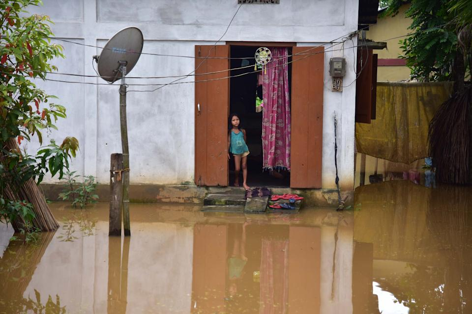 NAGAON,INDIA-JULY 22,2020 :A girl inside her partially submerged hut at a village in Nagaon district of Assam ,India- PHOTOGRAPH BY Anuwar Ali Hazarika / Barcroft Studios / Future Publishing (Photo credit should read Anuwar Ali Hazarika/Barcroft Media via Getty Images)