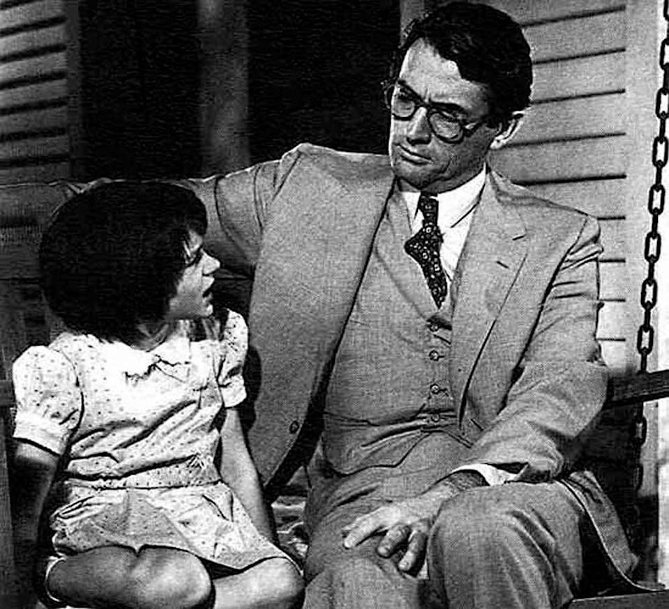 Mary Badham as Scout and Gregory Peck as Atticus Finch in To Kill a Mockingbird.