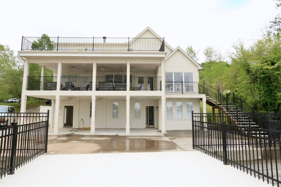 """<h2>Mountain Lake House Getaway</h2><br><strong>Location:</strong> Jefferson City, Tennessee<br><strong>Sleep:</strong> 16+<br><strong>Price Per Night:</strong> $445<br><em>Check availability <strong><a href=""""https://airbnb.pvxt.net/JvPYE"""" rel=""""nofollow noopener"""" target=""""_blank"""" data-ylk=""""slk:here"""" class=""""link rapid-noclick-resp"""">here</a></strong></em><br><br>""""The house is situated on a quiet wooded lot that can view the slopes of the Great Smoky Mountains while overlooking Cherokee Lake. It has so many spaces across three stories, with many large common rooms and porches, and is perfect for groups.""""<br><br>"""