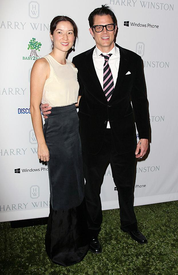 """Johnny Knoxville is best known for his work on """"Jackass,"""" but at home he's likely just a normal dad. The father of three hit the event with his wife, Naomi Nelson. (11/3/12)"""
