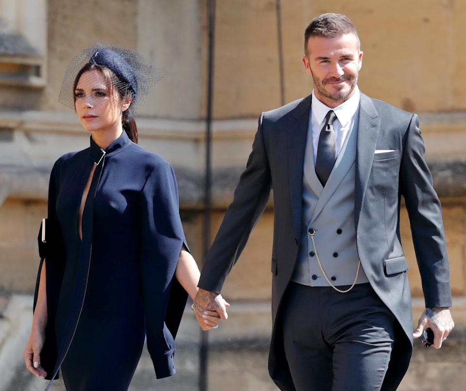 Victoria and David Beckham, attending Prince Harry and Meghan Markle's wedding on May 19, celebrated their 19th wedding anniversary together amid divorce gossip. (Photo: Max Mumby/Indigo/Getty Images)