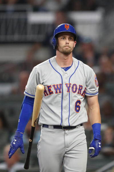 New York Mets' Jeff McNeil reacts after striking out to end the top of the fourth inning of the team's baseball game against the Atlanta Braves on Tuesday, Aug. 13, 2019, in Atlanta. The Braves won 5-3. (AP Photo/John Bazemore)